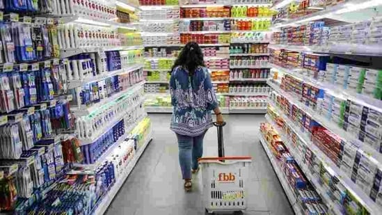 A shopper walks through an aisle displaying personal care goods at a Big Bazaar hypermarket, operated by Future Retail Ltd. in Mumbai(Bloomberg File Photo)