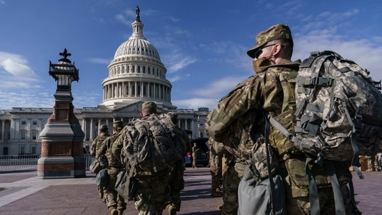 National Guard troops reinforce security around the U.S. Capitol ahead of expected protests leading up to President-elect Joe Biden's inauguration, in Washington, Sunday, Jan. 17, 2021, following the deadly attack on Congress by a mob of supporters of President Donald Trump. (AP Photo/J. Scott Applewhite)(AP)