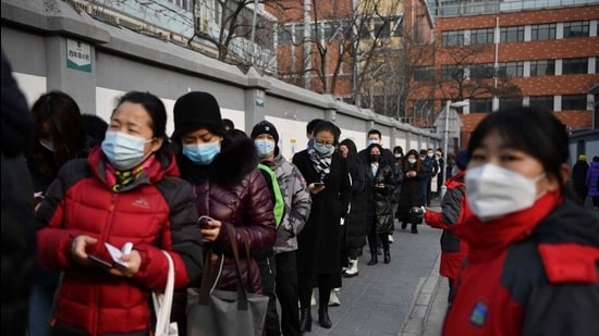 People line up to be tested for the Covid-19 coronavirus in Beijing on January 22. (AFP)