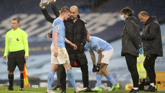 Manchester City's Kevin De Bruyne with Manchester City manager Pep Guardiola(Pool via REUTERS)