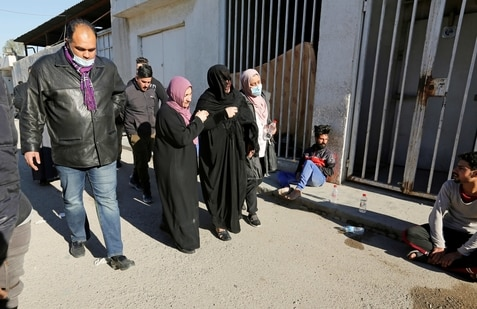 Women mourn as they walk outside the al-Kindi hospital morgue following a twin suicide bombing attack in a central Baghdad market, in Baghdad, Iraq(REUTERS)