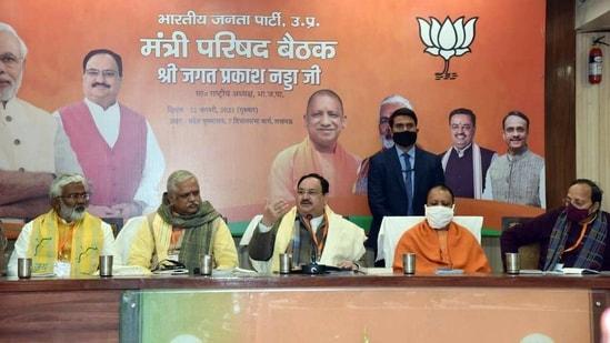 BJP national president J.P Nadda and Uttar Pradesh CM Yogi Adityanath during Uttar Pradesh state ministers' council meeting in Lucknow on Thursday. ((ANI Photo))