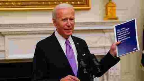 President Joe Biden holds a booklet as he speaks about the coronavirus in the State Dinning Room of the White House, Thursday, Jan. 21, 2021, in Washington. (AP Photo/Alex Brandon)(AP)