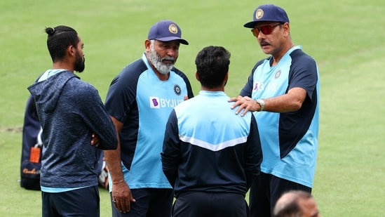 Indian coach Ravi Shastri, right, talks to players ahead of play on the final day of the fourth cricket test between India and Australia at the Gabba, Brisbane, Australia.(AP)