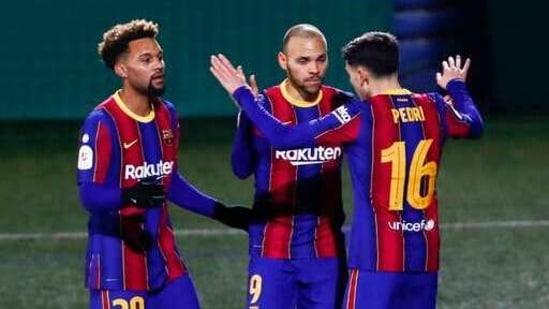 Barcelona's Martin Braithwaite, second left, celebrates after scoring his side's second goal during a Spanish Copa del Rey round of 32 soccer match between Cornella and FC Barcelona at the Nou Municipal stadium in Cornella,(AP)