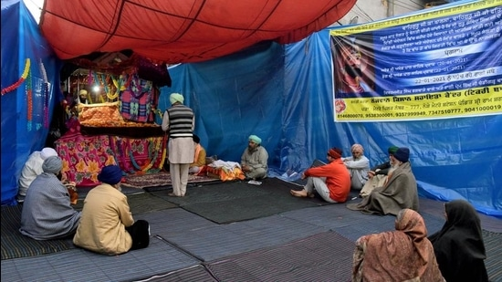 Farmers offering prayer at makeshift a gurdwara at Tikri border during their protest against farm laws, in New Delhi on Thursday. (ANI)