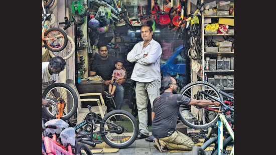 """""""Whether it's a toddler getting on their first bike or an office-goer getting back on a cycle after decades, I am always happy to see it,"""" says Abdul Hamid Khan of Mumbai's iconic Happy Cycle Shop. (Anshuman Poyrekar / HT)"""