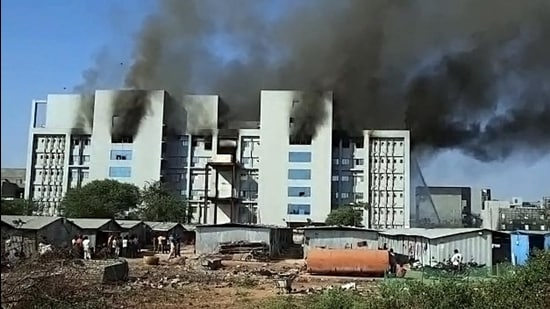 Smoke billowing out of the SII facility which caught fire, in Pune on Thursday. (ANI)