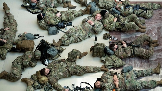 A number of the 25,000 troops standing guard around the US Capitol in recent days in the wake of the January 6 insurrection had been allowed to take breaks and naps in between long shifts on the floors of the building housing the US Congress.(AFP)