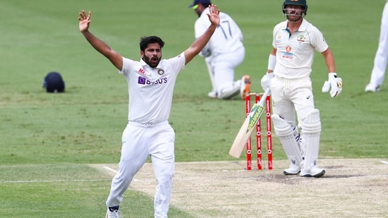 India's Shardul Thakur, left, appeals unsuccessfully for the wicket of Australia's David Warner during play on day four of the fourth cricket test between India and Australia at the Gabba.(AP)