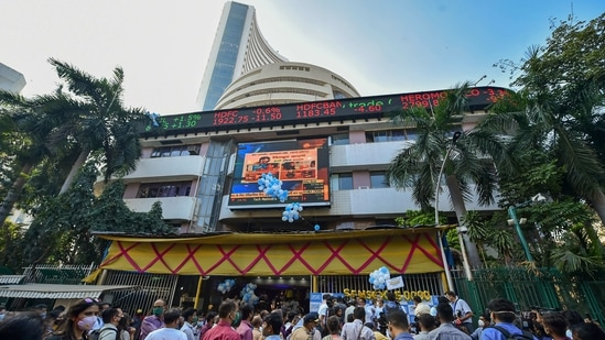 Celebrations at BSE after the sensex crossed 50000 mark for the first time, in Mumbai.(PTI Photo)