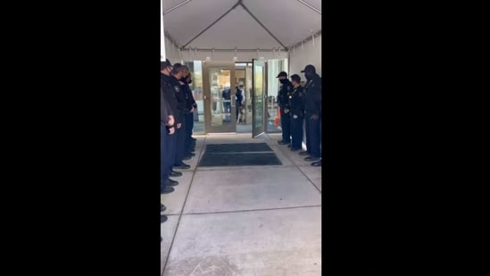 The image shows the cops welcoming Arlo.(Facebook/@Thurston County-Sheriff)