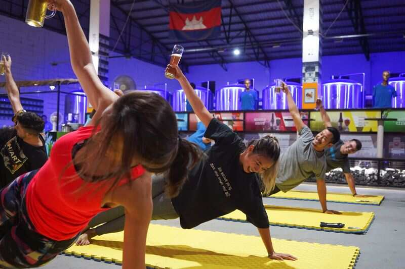 At a craft brewery in Phnom Penh, Cambodia, people participate in a beer yoga session, while the country eases the restrictions of coronavirus disease (COVID-19). (REUTERS)