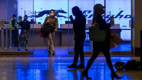 Commuters walk past the Greyhound ticket office at Port Authority Bus Terminal, Friday, Jan. 22, 2021, in New York. The Port Authority of New York and New Jersey unveiled a proposal Thursday, Jan. 21, to rebuild and expand the embattled midtown Manhattan bus terminal. (AP Photo/Mary Altaffer)(AP)
