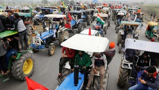 FILE PHOTO: Farmers participate in a tractor rally to protest against the newly passed farm bills, on a highway on the outskirts of New Delhi, India, January 7, 2021. REUTERS/Adnan Abidi/File Photo(REUTERS)
