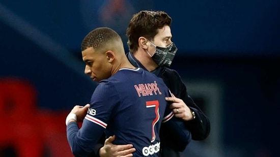 Paris St Germain coach Mauricio Pochettino with Kylian Mbappe.(REUTERS)