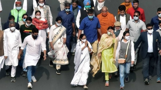 West Bengal chief minister Mamata Banerjee leads a massive crowd during the celebration rally to mark the birth anniversary of Netaji Subhas Chandra Bose, in Kolkata on Saturday. (ANI PHOTO).