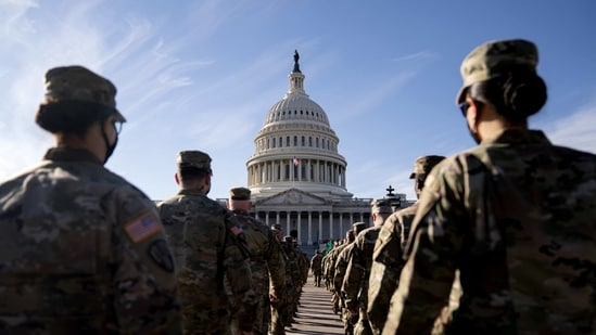 Members of the National Guard march towards the US Capitol in Washington, DC(Bloomberg)