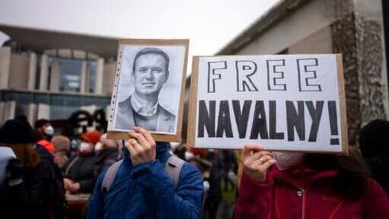 People show posters as they as they attend a protest against the jailing of Russian opposition leader Alexei Navalny, in front of the chancellery in Berlin, Germany, Saturday, Jan. 23, 2021. A Russian judge had ordered opposition leader Alexei Navalny jailed for 30 days, after the leading Kremlin critic returned to Russia from Germany where he was recovering from nerve agent poisoning. (AP Photo/Markus Schreiber)(AP)