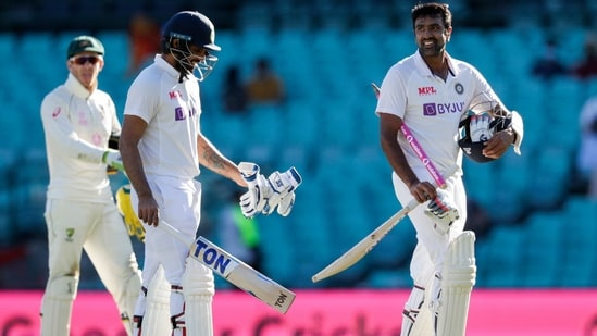 Not out batsman India's Ravichandran Ashwin, right, and Hanuma Vihari walk from the field.(AP)