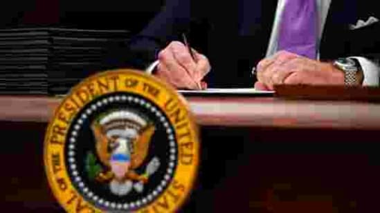 FILE - In this Jan. 21, 2021, file photo President Joe Biden signs executive orders after speaking about the coronavirus in the State Dinning Room of the White House in Washington. (AP Photo/Alex Brandon, File)(AP)