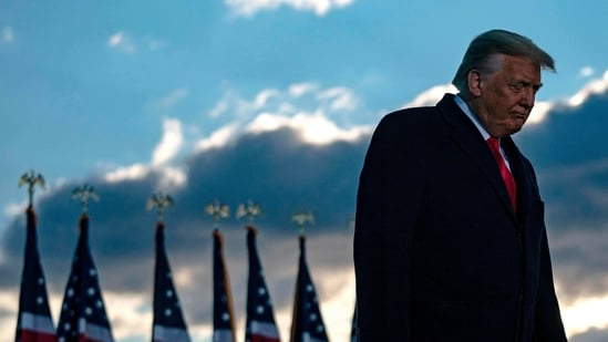 Outgoing US President Donald Trump addresses guests at Joint Base Andrews in Maryland on January 20, 2021.(AFP)