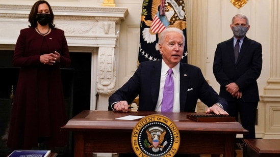 President Joe Biden reacts to a reporters question after signing executive orders in the State Dinning Room of the White House, in Washington.(AP)