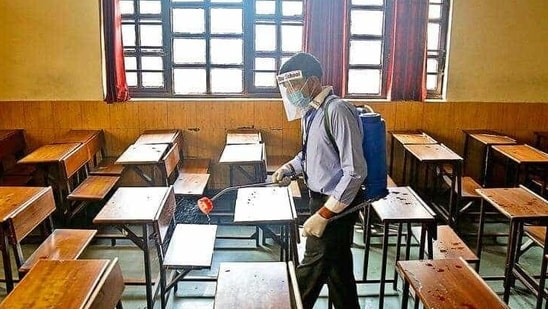 A classroom being sanitised( anchit Khanna/HT PHOTO)