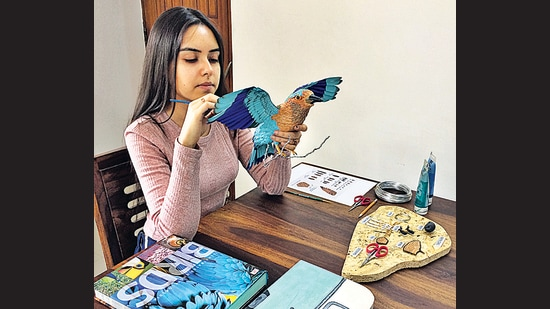 Niharika Rajput at work on a paper sculpture of the Indian Roller.