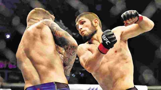 Khabib Nurmagomedov of Russia in an MMA bout with Dustin Poirier of the US, earlier this month. Nurmagomedov — a legend who has single-handedly boosted the profile of the sport — recently announced that he's retiring, following the death of his father and coach earlier this year.(Mahmoud Khaled / AP File Photo)