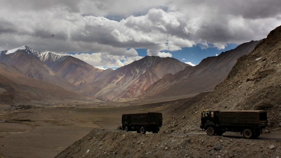 In this file photo, Indian army trucks drive near Pangong Tso lake near the India China border in Ladakh area. (AP)