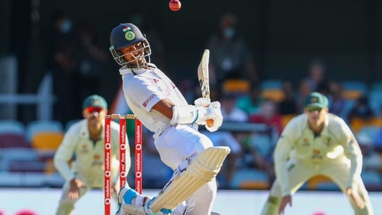 India's Washington Sundar avoids a bouncer during play on the final day of the fourth cricket test between India and Australia at the Gabba, Brisbane, Australia, (AP)