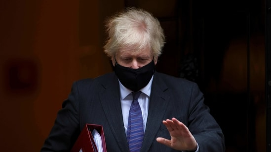 Britain's Prime Minister Boris Johnson leaves Downing Street in London, Britain, January 20, 2021.(REUTERS)