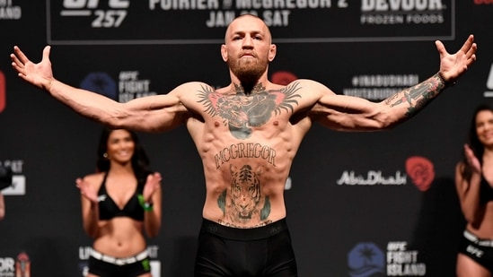 Conor McGregor of Ireland poses on the scale during the UFC 257 weigh-in at Etihad Arena on UFC Fight Island on January 22, 2021 in Abu Dhabi, United Arab Emirates. (USA TODAY Sports)
