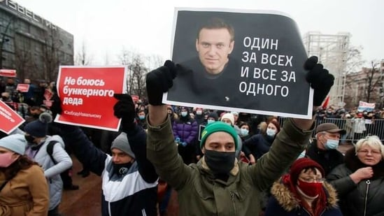 "A participant holds a placard reading ""One for all, all for one"" during a rally in support of jailed Russian opposition leader Alexei Navalny.(REUTERS)"