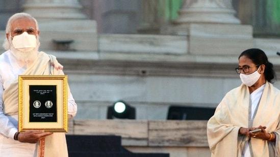 Prime Minister Narendra Modi and West Bengal CM Mamata Banerjee during a Parakram Diwas celebration event on the occasion of Netaji Subash Chandra Bose 125th birth anniversary, at Victoria Memorial in Kolkata on January 23, 2021. (ANI Photo)