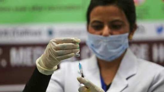 A health worker prepares to administer a Covid-19 vaccine to a hospital staff at a government Hospital in Jammu, India.