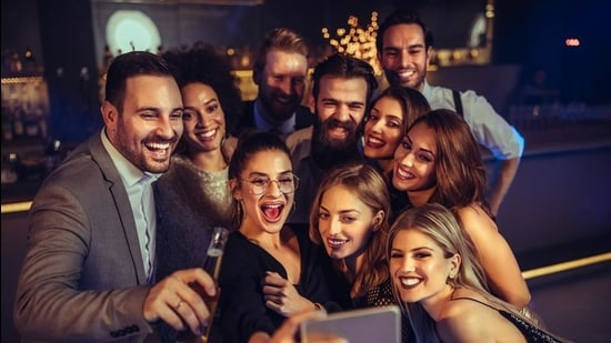 Today, it's more important to know who is invited to the party and (more juicier) who's not; what everyone's wearing; and pictures that have to be taken to be discussed later. (Shutterstock)