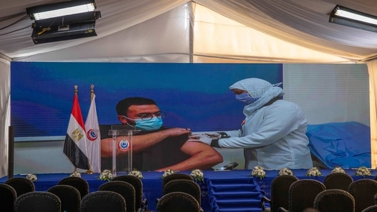 Dr. Abdel Menoim Selim, is shown on a live screen receiving the Sinopharm Covid-19 vaccine, ahead of a press conference, at the Abu Khalifa Hospital in Ismailia, 120 kilometers (75 miles) east of Cairo, Egypt,(AP)