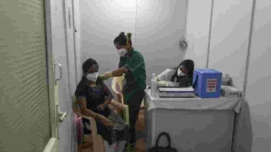 A healthcare worker gets the Covid-19 vaccine shot at the BKC vaccination centre on January 16. (HT FILE)