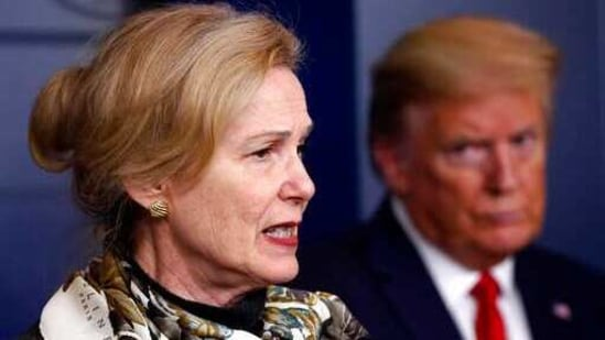 Donald Trump listens as Dr Deborah Birx, White House coronavirus response coordinator, speaks about the coronavirus.(AP)