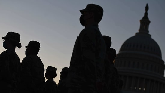 Hundreds of National Guard members are camped out at the Capitol to protect lawmakers, some still reeling from the violence and preparing for Biden's inauguration next week.(AFP)