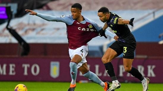 Aston Villa's Ezri Konsa, left, holds off Newcastle's Callum Wilson.(AP)