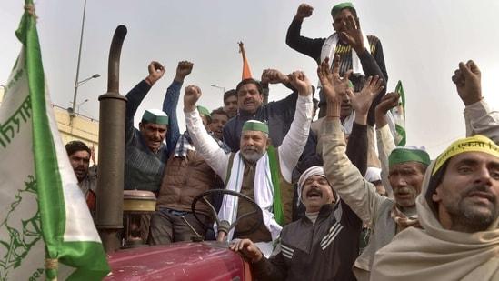 BKU spokesperson Rakesh Tikait along with farmers raises slogans during their ongoing agitation against Centre's farm reform laws at Ghazipur border,