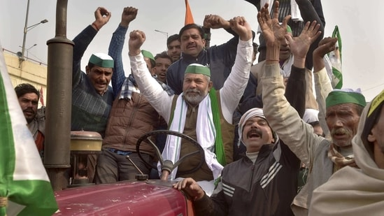 BKU spokesperson Rakesh Tikait along with farmers raises slogans during their ongoing agitation against Centre's farm reform laws at Ghazipur border, (PTI)