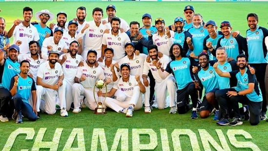 Indian players pose with the winning trophy after defeating Australia.(PTI)
