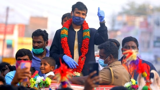 Indian left-arm pacer T Natarajan gestures during a grand welcome ceremony, organised by his villagers, at Chinnappampatti in Salem district, Thursday, Jan. 21, 2021. Natrajan was part of the Indian cricket team which defeated Australia in the recent test series by 2-1.(PTI)