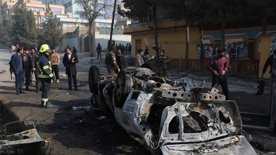 Afghan security officers inspect the site of a bombing attack in Kabul, Afghanistan, Sunday, Jan. 10, 2021. A roadside bomb exploded in Afghanistan's capital Sunday, killing at least a few people in a vehicle, the latest attack to take place even as government negotiators are in Qatar to resume peace talks with the Taliban. (AP Photo/Rahmat Gul)(AP)