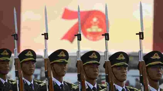 """Members of a Chinese military honour guard stand at attention during a rehearsal before the parade in Beijing. In his speech, Xi said China """"must adhere"""" to the one country, two systems policy governing Hong Kong and """"maintain the long-term prosperity and stability"""" of the city. (Mark Schiefelbein / AP)"""