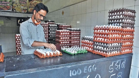 A shopkeeper arranges eggs in a tray in Thane district in this file photo. (Praful Gangurde/HT Photo)